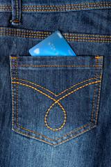 Cash card in jeans back pocket