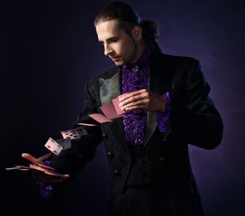 Young brunette magician in stage costume
