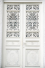 A modern single wooden door painted in white