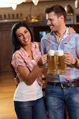 Happy young couple drinking beer