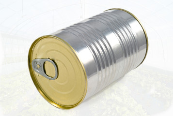 A tin food can isolated on greenhouse background