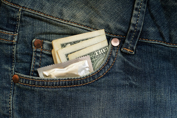 Condom and three dollars in the pocket jeans