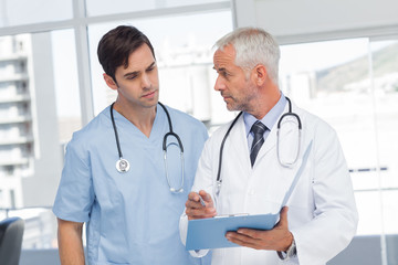 Doctors talking about a file