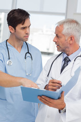 Serious doctors talking about file