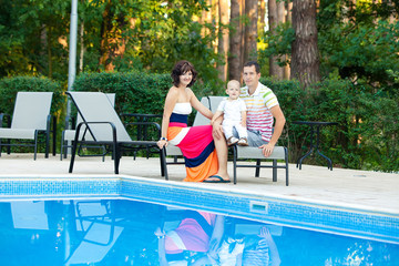 Happy family takes rest at the pool