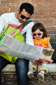 Dad and daughter looking at a map