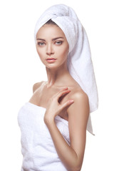 Beautiful young woman posing in white towel.