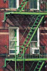 Brick apartment building with stairs in Manhattan, New York.