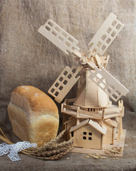 bread and mill on sacking background
