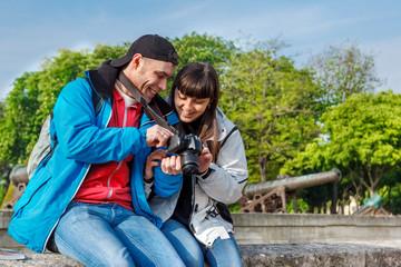 Tourists viewing photos