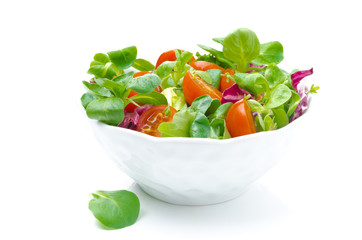 bowl of fresh salad and cherry tomatoes isolated on white