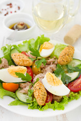 salad with fish and egg on the plate