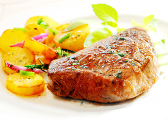 Thick juicy steak with crisp roast potatoes
