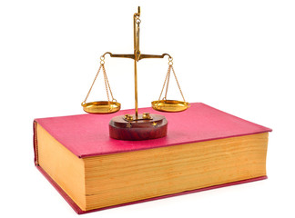 book and scales of justice over white background