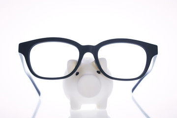 White piggy bank with glasses