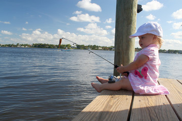 Toddler Girl Fishing on Dock