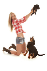 woman with dog hold up pig