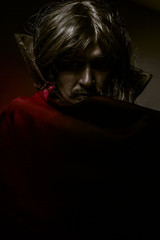 Vampire with red coat and long hair, halloween