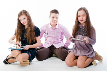 group of children with tablet computers