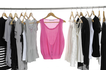 collection of women's clothes hanging on a rack.