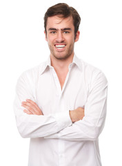 Happy young man in white shirt isolated