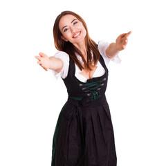 attraktive junge Frau im Dirndl bei freudiger Begrüßung