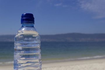Bottle of water on the seashore