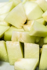 Melon sliced in small pieces,  close up