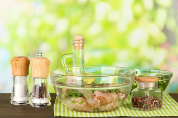 Chicken meat in glass bowl,herbs and spices