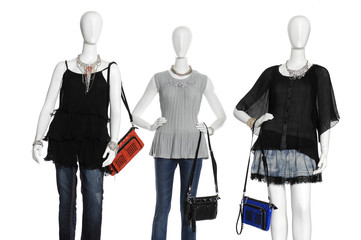 Three  female clothing in jeans with scarf, bag on mannequin