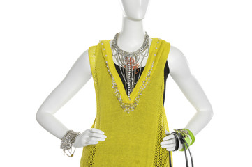 female clothing in bracelet , jewelry with bag on mannequin