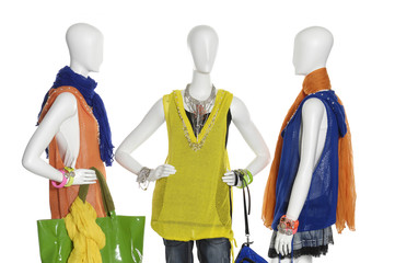 fashion dress with handbag on female three mannequin