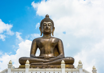 gold Buddha statue of thailand on sky