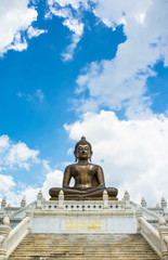 front view Buddha statue of thailand on sky