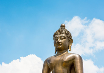 top half Buddha statue of thailand on sky