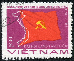 stamp printed in Viet Nam showing flag with sickle and hammer