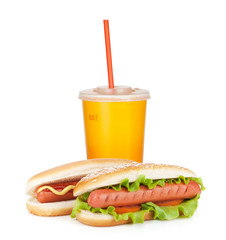 Fast food drink and two hot dogs with various ingredients