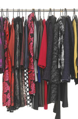 women's clothes hanging on a rack.