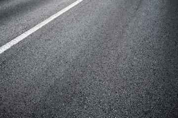 Detail of asphalt road with white line