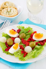 salad with boiled egg, grilled pepper and olives