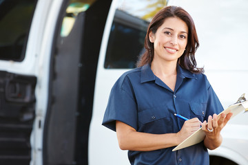 Portrait Of Female Delivery Driver With Clipboard