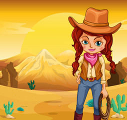 A cowgirl holding a rope standing in the desert