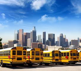 school bus in a row at LA skyline photo mount