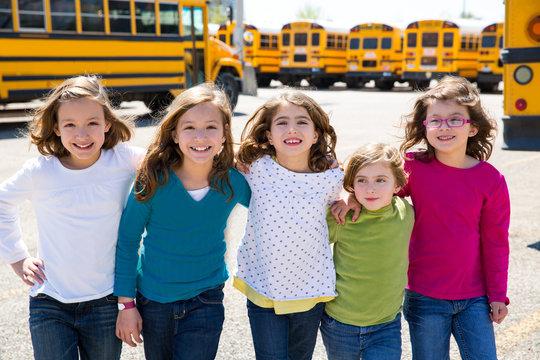 school girls friends in a row walking from school bus