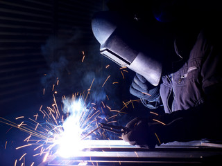 Welder on the building. Construction and manufacturing