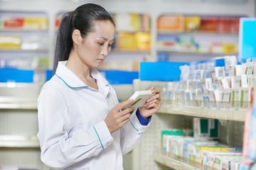 Chinese pharmacy chemist woman in china drugstore