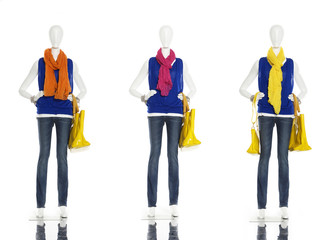 female clothes in jeans with scarf on three  mannequin