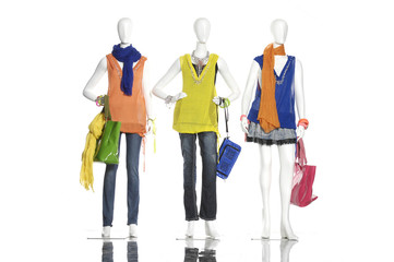 Full female clothes in scarf with bag on three  mannequin
