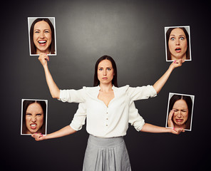 woman holding pictures with different mood