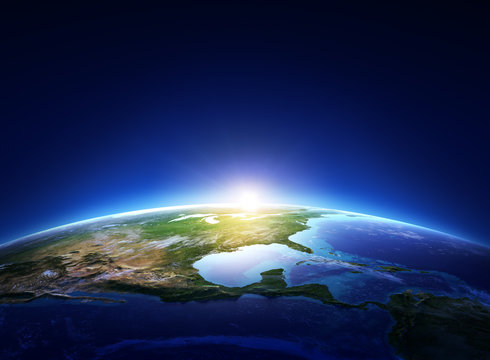 Earth sunrise North America with light clouds